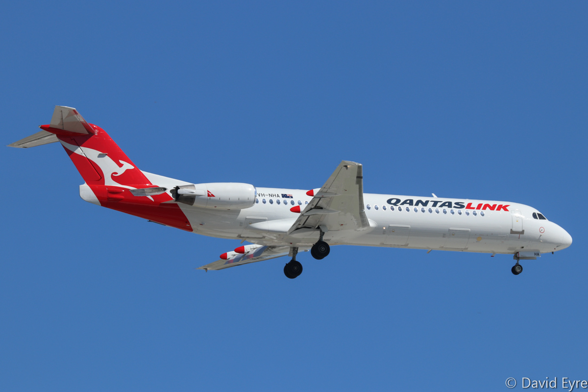 VH-NHA Fokker 100 (MSN 11490) of QantasLink (Network Aviation), at Perth Airport - Thu 16 February 2017. 'NETLINK 1615' from Port Hedland, on approach to runway 24 at 3:30pm. Photo © David Eyre