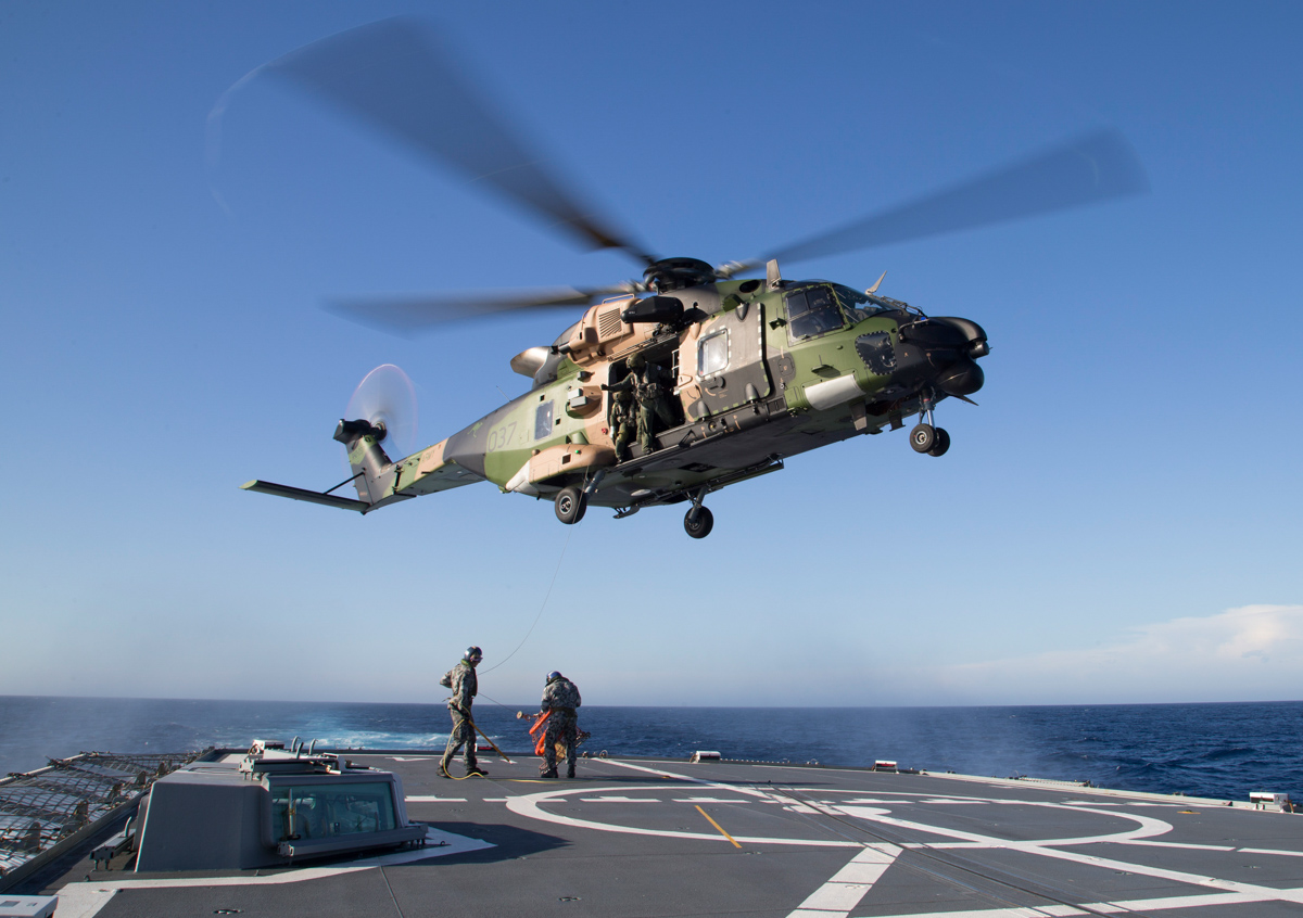 A40-037 NH Industries MRH90 Taipan (MSN TAUA37) of the Australian Army, over the flight deck of HMAS Parramatta (FFH154). off the Western Australian coast - 1 March 2017. Deployed aboard HMAS Adelaide (L01). Conducting rescue net training during Exercise Ocean Explorer 17. Photo © Commonwealth of Australia, ABIS Richard Cordell
