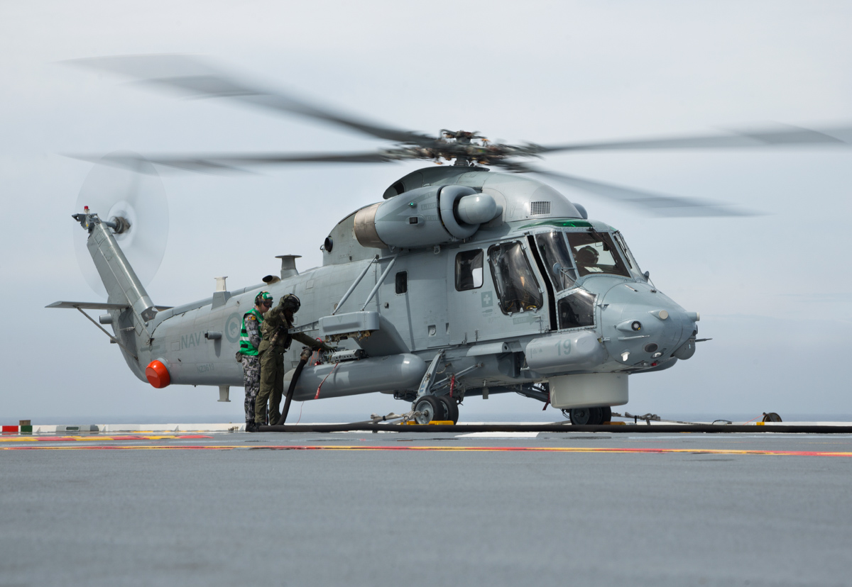 NZ3619 Kaman SH-2G(I) Seasprite (MSN 147) of 6 Squadron, Royal New Zealand Air Force (operated for Royal New Zealand Navy), hot-refuelling aboard HMAS Adelaide (L01), off the Western Australian coast - 2 March 2017. Deployed aboard the Royal New Zealand Navy frigate HMNZS Te Kaha (F77), during Exercise OCEAN EXPLORER 17. This airframe has an interesting history - built in 1964 for the US Navy as a UH-2B Seasprite, with serial 151310, later converted to UH-2C, then rebuilt in 1975 as an SH-2F. Served with USN until 1 June 1993 and stored at AMARC Davis-Monthan AFB on 4 June 1993. Had 9570 hours on airframe. On 14 May 1998 it was sent to Kaman at Bloomfield, Connecticut for rebuild as SH-2G(A) for the Royal Australian Navy. Reassembled at NAS Nowra, NSW. Entered service with 805 Sqn, RAN on 24 February 2004 as N29-151310. RAN Seasprite Project was cancelled 20 March 2008 and aircraft was returned to Kaman. Converted to SH-2G(I) for Royal New Zealand Air Force (operated for Navy). On 27 March 2014, it was registered N705KM to Kaman Aerospace Corporation, Bloomfield, CT. It was delivered to the RNZAF as NZ3619. Photo © Commonwealth of Australia, LSIS Peter Thompson.
