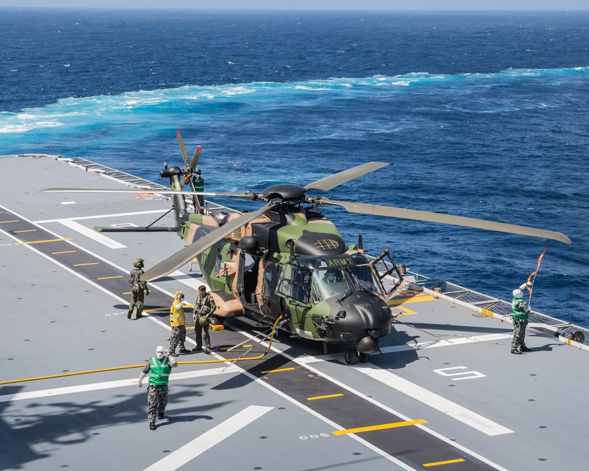 A40-037 NH Industries MRH90 Taipan (MSN TAUA37) of the Australian Army, on the flight deck of HMAS Adelaide (L01). off the Western Australian coast - 6 March 2017. MRH-90 helicopter is being prepared for flying on the flight deck of HMAS Adelaide, as the ship conducts defensive manoeuvres against a simulated air attack during Exercise Ocean Explorer 17. Photo © Commonwealth of Australia, LSIS Peter Thompson