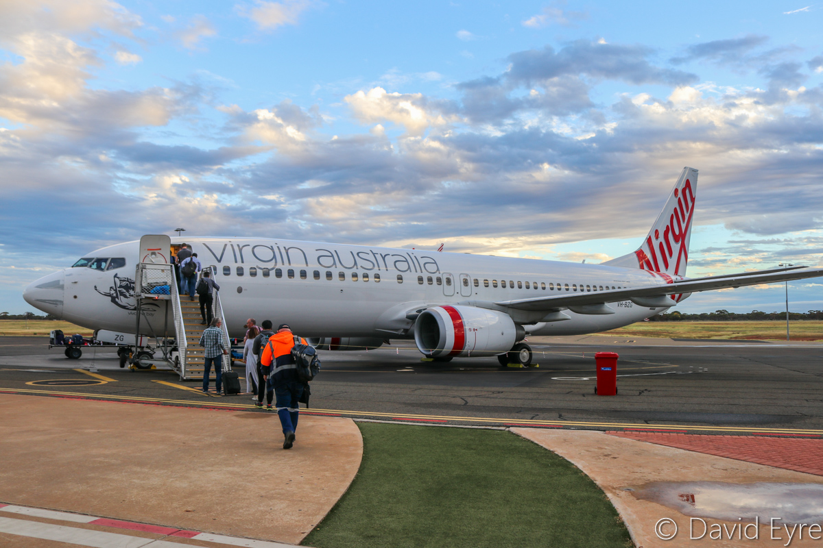 VH-BZG Boeing 737-8FE (MSN 37822/3355) of Virgin Australia, named 'Vivonne Bay', at Kalgoorlie-Boulder Airport – Wed 22 March 2017. Boarding the aircraft at Stand 1 at 5:40pm for flight VA1858 back to Perth. Engines started at 6:03pm, but we remained there with engines running as air traffic controllers claimed that the flight plan was not showing in their system. We eventually started taxying out at 6:18pm and were airborne at 6:20pm. Photo © David Eyre