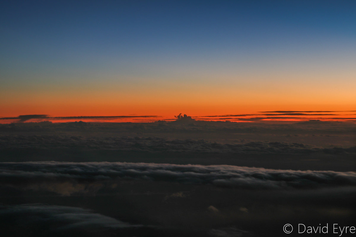 Sunset above clouds near Marvel Loch Mine, seen from VH-BZG Boeing 737-8FE (MSN 37822/3355) of Virgin Australia, named 'Vivonne Bay' – Wed 22 March 2017. Flight VA1858 from Kalgoorlie to Perth. At 34,000 feet at 6:40pm. Viewed from seat 13A, the forward overwing exit seat on the left side. Photo © David Eyre