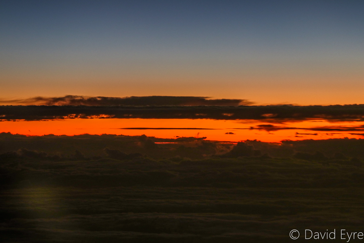 Sunset above clouds near Brookton, east of Perth, seen from VH-BZG Boeing 737-8FE (MSN 37822/3355) of Virgin Australia, named 'Vivonne Bay' – Wed 22 March 2017. Flight VA1858 from Kalgoorlie to Perth. At 23,000 feet at 7:03pm, around 60 kilometres ENE of Brookton, 265km ESE of Perth Airport. Viewed from seat 13A, the forward overwing exit seat on the left side. Photo © David Eyre