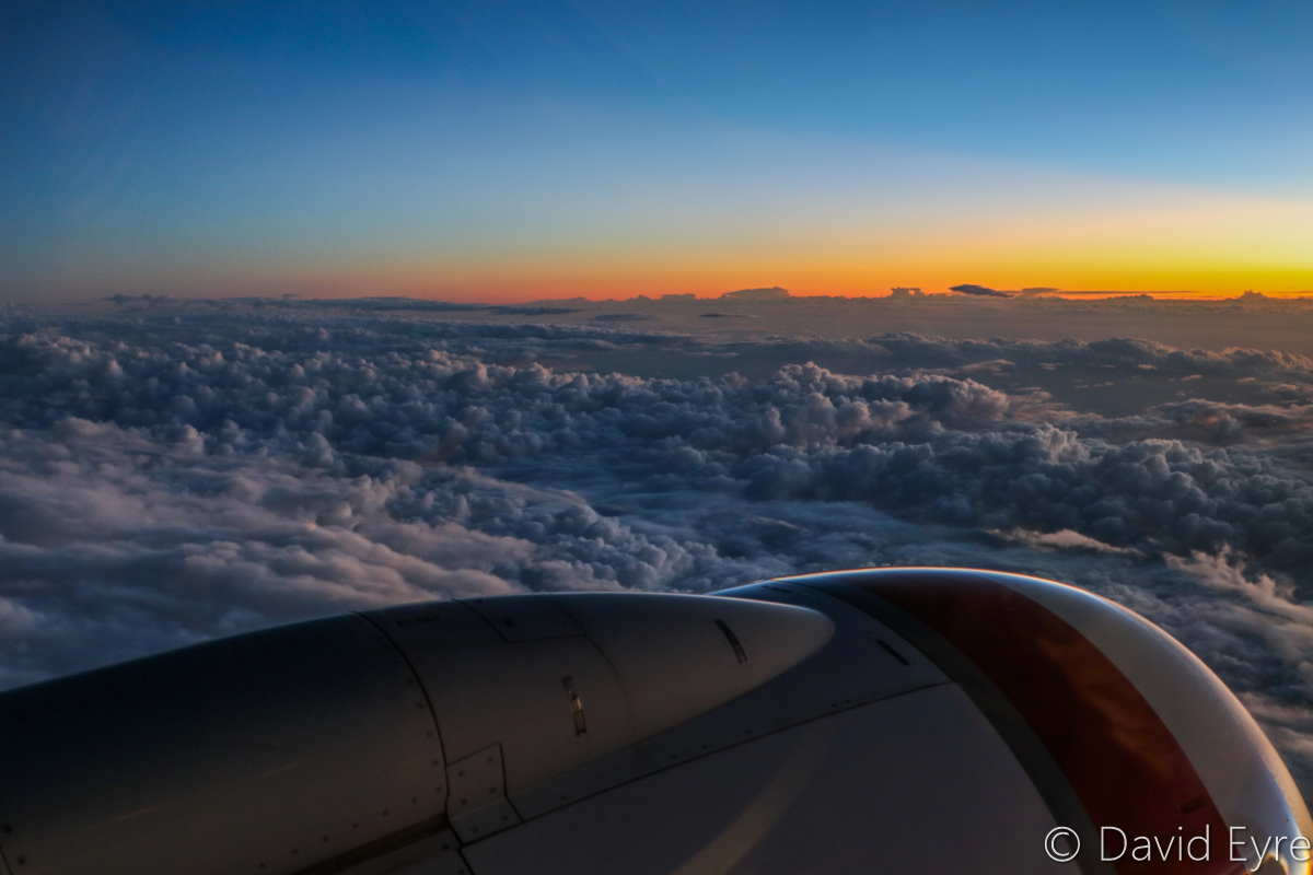Sunset above clouds near Mount Palmer, seen from VH-BZG Boeing 737-8FE (MSN 37822/3355) of Virgin Australia, named 'Vivonne Bay' – Wed 22 March 2017. Flight VA1858 from Kalgoorlie to Perth. 144km SW of Kalgoorlie-Boulder Airport, at 6:35pm (27 minutes after sunset), at 33,000 feet. Viewed from seat 13A, the forward overwing exit seat on the left side. Photo © David Eyre