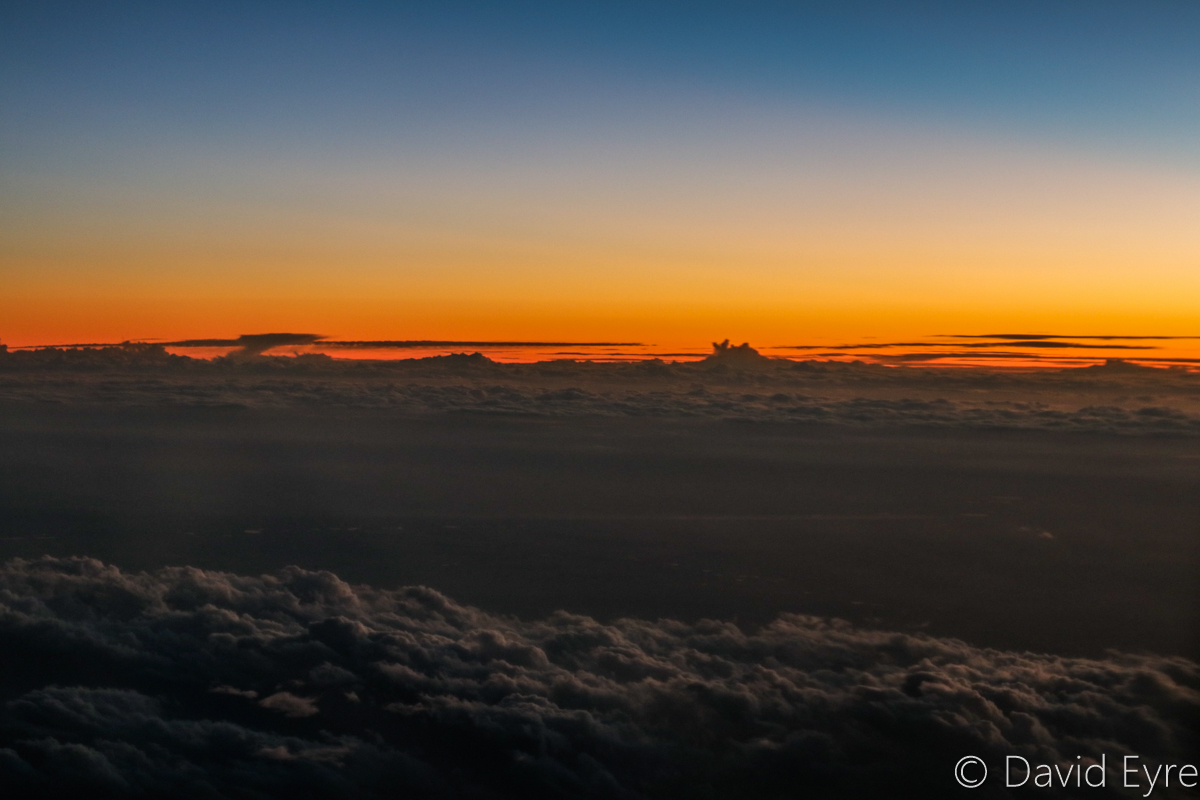 Sunset above clouds near Marvel Loch Mine, seen from VH-BZG Boeing 737-8FE (MSN 37822/3355) of Virgin Australia, named 'Vivonne Bay' – Wed 22 March 2017. Flight VA1858 from Kalgoorlie to Perth. At 34,000 feet at 6:38pm. Viewed from seat 13A, the forward overwing exit seat on the left side. Photo © David Eyre