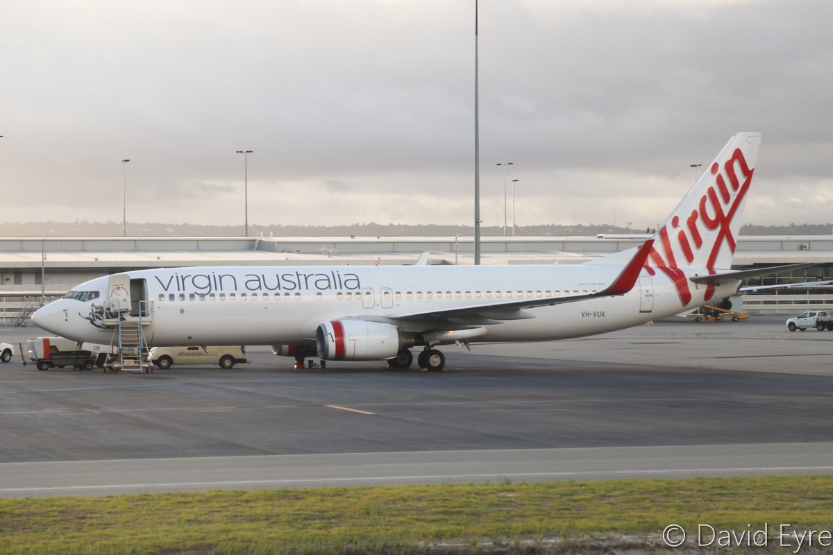 VH-VUK Boeing 737-8FE (MSN 36602/2353) of Virgin Australia, named 'Seaford Beach', at Perth Airport – Wed 22 March 2017. Parked near Terminal 2. Seen from aboard VH-YFW Boeing 737-8FE of Virgin Australia, whilst taxying out as VA1849 to Kalgoorlie at 7:11am. Photo © David Eyre