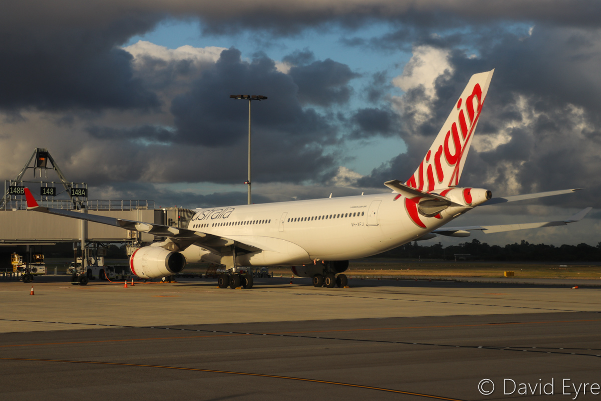 VH-XFJ Airbus A330-243 (MSN 1561) of Virgin Australia, named 'Gnaraloo Bay', at Perth Airport – Wed 22 March 2017. Flight VA556 to Sydney, parked on Bay 148, which departed at 10:39am. Seen from aboard VH-YFW Boeing 737-8FE of Virgin Australia, whilst taxying out as VA1849 to Kalgoorlie at 7:07am. Photo © David Eyre