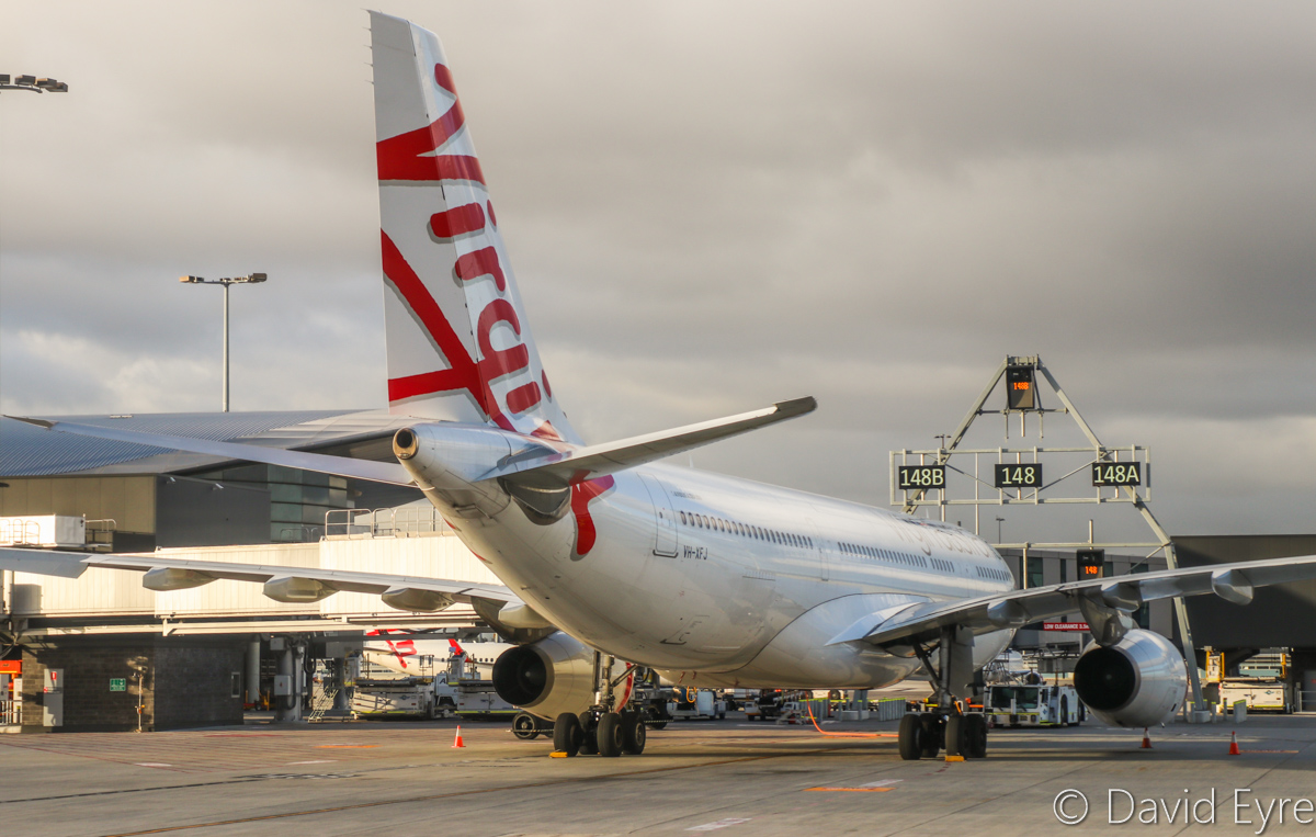 VH-XFJ Airbus A330-243 (MSN 1561) of Virgin Australia, named 'Gnaraloo Bay', at Perth Airport – Wed 22 March 2017. Flight VA556 to Sydney, parked on Bay 148, which departed at 10:39am. Seen from aboard VH-YFW Boeing 737-8FE of Virgin Australia, whilst taxying out as VA1849 to Kalgoorlie at 7:09am. Photo © David Eyre