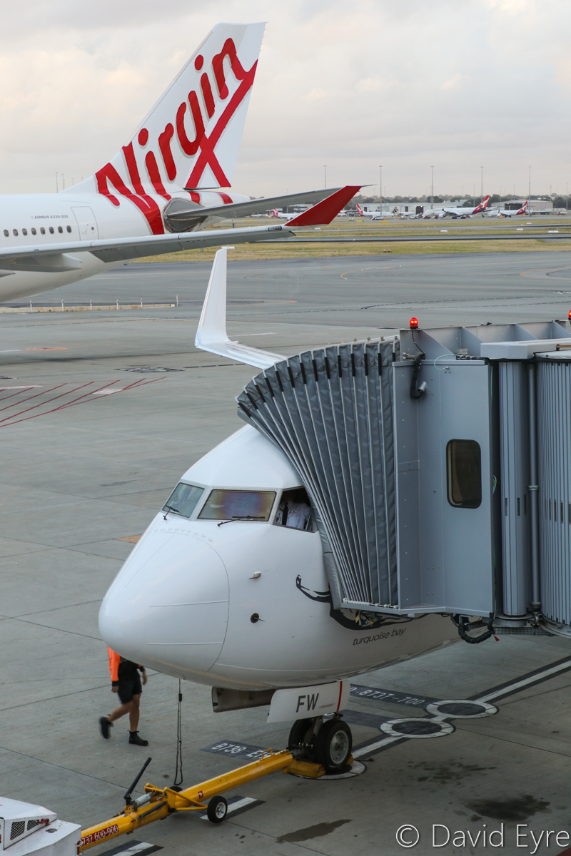 VH-YFW Boeing 737-8FE (MSN 41037/5978) of Virgin Australia, named 'Turquoise Bay', at Perth Airport – Wed 22 March 2017. VA1849 to Kalgoorlie, parked at Bay 149A and boarding passengers at 6:50am. Next to it on bay 148 is VH-XFJ Airbus A330-243 of Virgin Australia. Photo © David Eyre