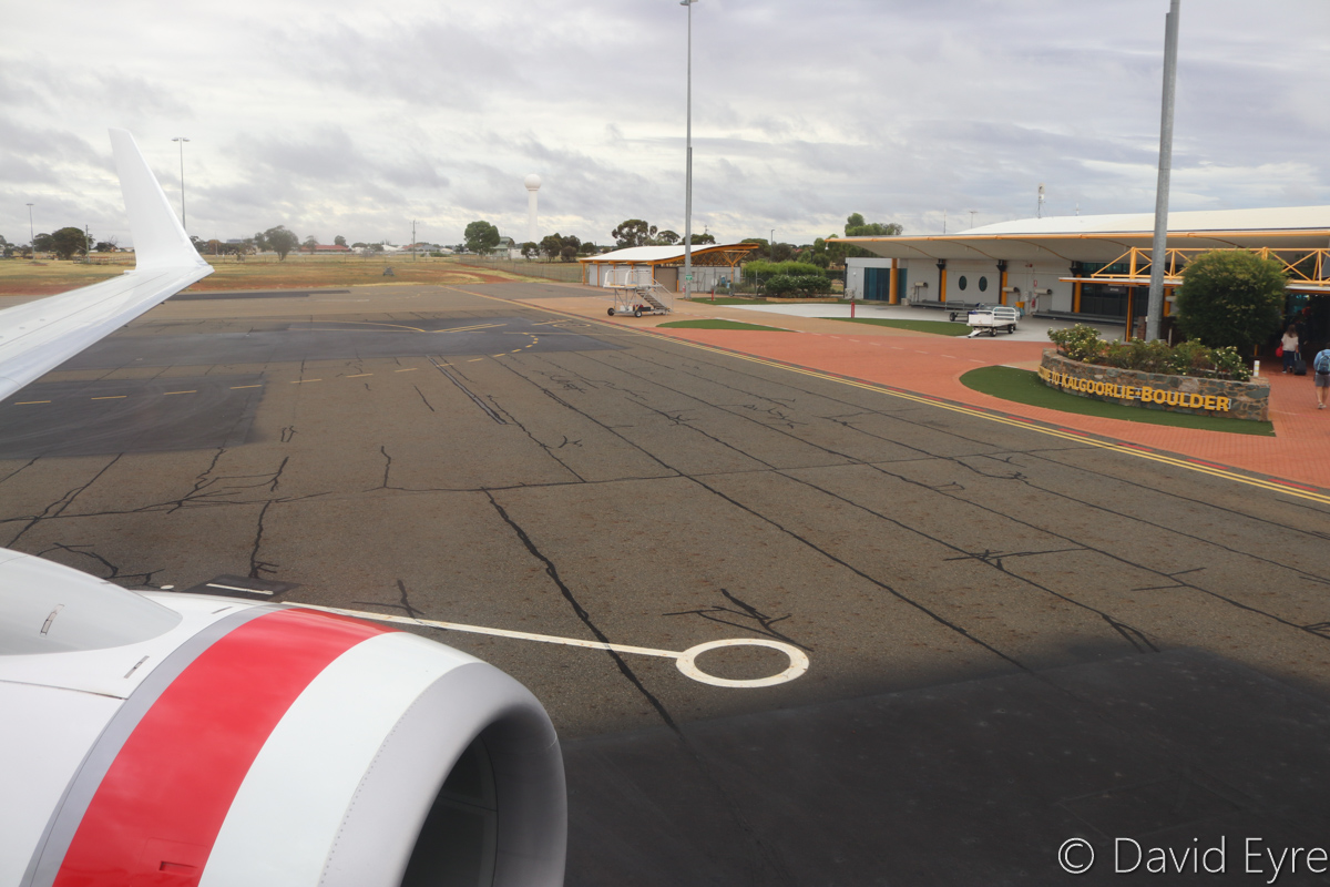 Terminal, seen from VH-YFW Boeing 737-8FE (MSN 41037/5978) of Virgin Australia, named 'Turquoise Bay', at Kalgoorlie-Boulder Airport – Wed 22 March 2017. Passengers disembarking after arrival, at 8:14am. Kalgoorlie Aerodrome was built during 1928-1929. Ownership was transferred from the Commonwealth Government to the Shire of Boulder in 1989. A new terminal and runway was opened in November 1992. Photo © David Eyre