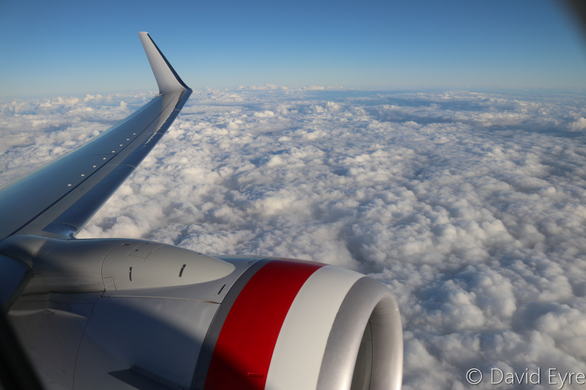 Clouds over the Darling Range hills east of Perth, seen from VH-YFW Boeing 737-8FE (MSN 41037/5978) of Virgin Australia, named 'Turquoise Bay' – Wed 22 March 2017. View facing north at around 16,000-17,000 feet on flight VA1849 from Perth to Kalgoorlie at 7:22am. Photo © David Eyre