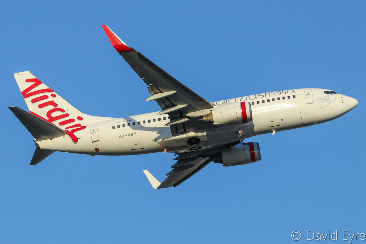 "VH-VBY Boeing 737-7FE (MSN 34323/1751) of Virgin Australia, named ""Kingston Beach"" at Perth Airport – Fri 31 March 2017. Flight VA722 yo Adelaide, climbing after take-off from runway 21 at 5:32pm. One of only two 737-700s remaining in Virgin Australia's fleet. Photo © David Eyre"