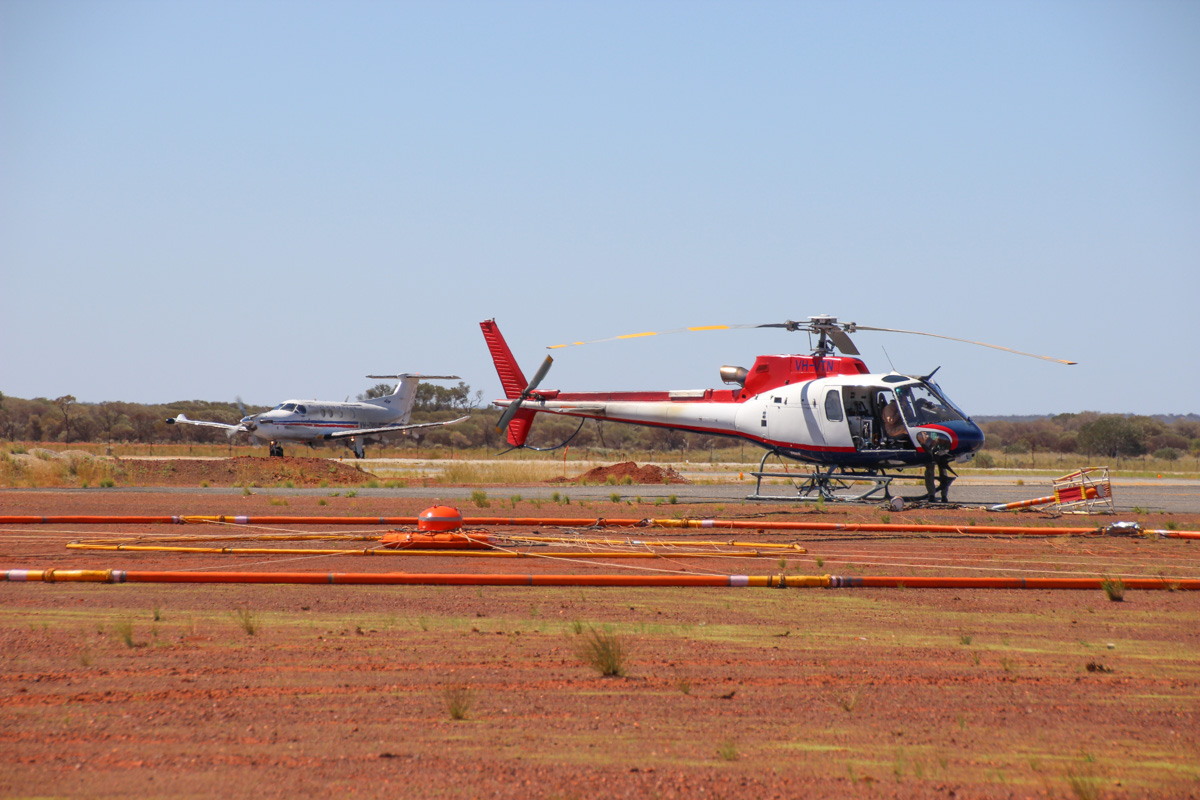 VH-VTN Eurocopter AS350B3 Squirrel (MSN 4527) operated by Geotech Airborne Pty Ltd, at Meekatharra Airport - Fri 31 March 2017. Used for airborne geophysical survey - the transmitter-receiver loop in the foreground is part of the VTEM (Versatile Time-domain Electro Magnetic) system, used to detect variations in the Earth's magnetic field to find minerals below the ground surface. A magnetometer is attached to the line above the transmitter-receiver loop - this can be seen resting on the ground to the right of the helicopter. The helicopter carries this loop and magentometer as a sling load. Photo © Geoff Carberry