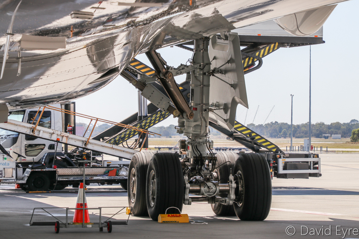 9V-SMK Airbus A350-941 (MSN 084) of Singapore Airlines, at Perth Airport - Wed 5 April 2017. Close-up of the left main landing gear, seen from the front. First visit to Perth, a one-off visit (instead of the usual Boeing 777-200ER) to commemorate the 50 years of Singapore Airlines services to Perth. Flight SQ213 from Singapore, parked at Bay 151 at 12:55pm. Photo © David Eyre