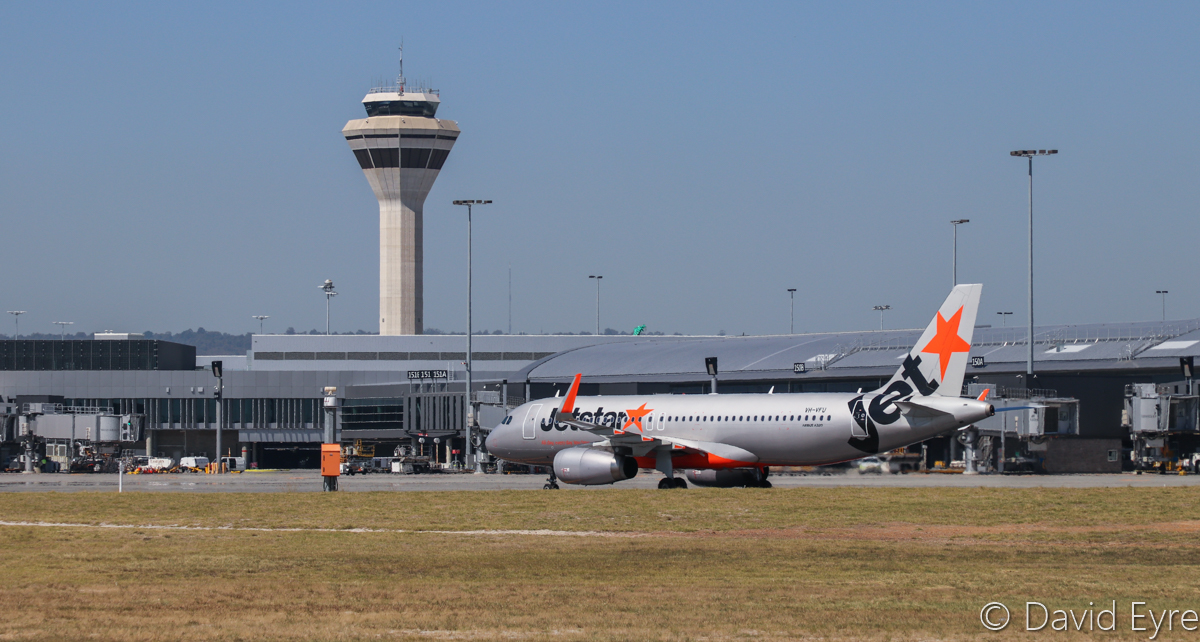 VH-VFU Airbus A320-232 (MSN 5814) of Jetstar, Terminal 1 International, Terminal 1 Domestic and Control Tower at Perth Airport - Wed 5 April 2017. Seen from runway 06/24, near the intersection of runway 03/21. VH-VFU just arrived from Denpasar (Bali) as JQ117 at 12:19pm. Photo © David Eyre