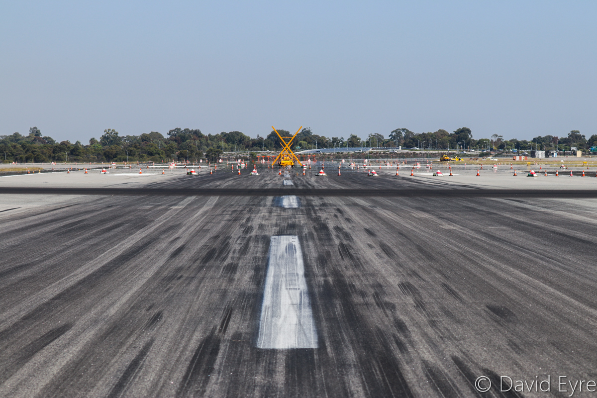 Runway 24 at Perth Airport - Wed 5 April 2017. Facing towards the runway 06 threshold. The runway was temporarily closed on this date, for installation of Category 3 high intensity lighting. Runway 21 is the black line running left to right. Photo © David Eyre