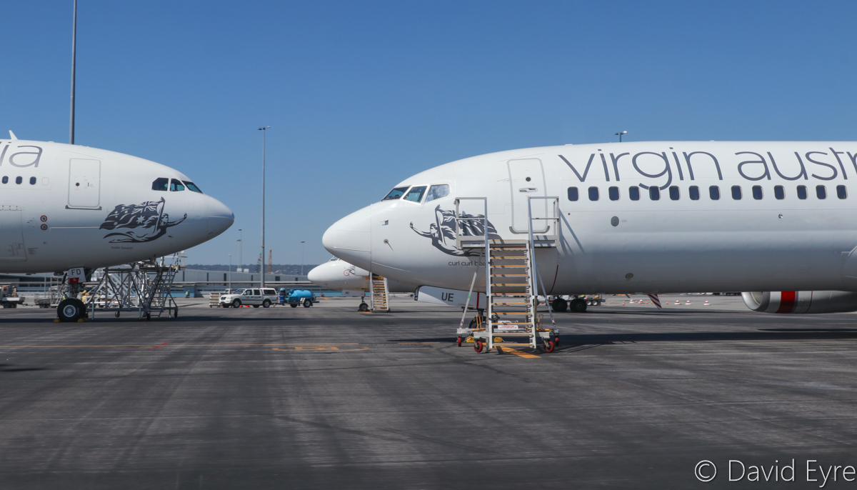 VH-XFD Airbus A330-243 (MSN 1306) named 'Bells Beach'. and VH-VUE Boeing 737-8FE (MSN 34167/1676) named 'Curl Curl Beach', of Virgin Australia at Perth Airport - Wed 5 April 2017. Parked near Terminal 2. Photo © David Eyre