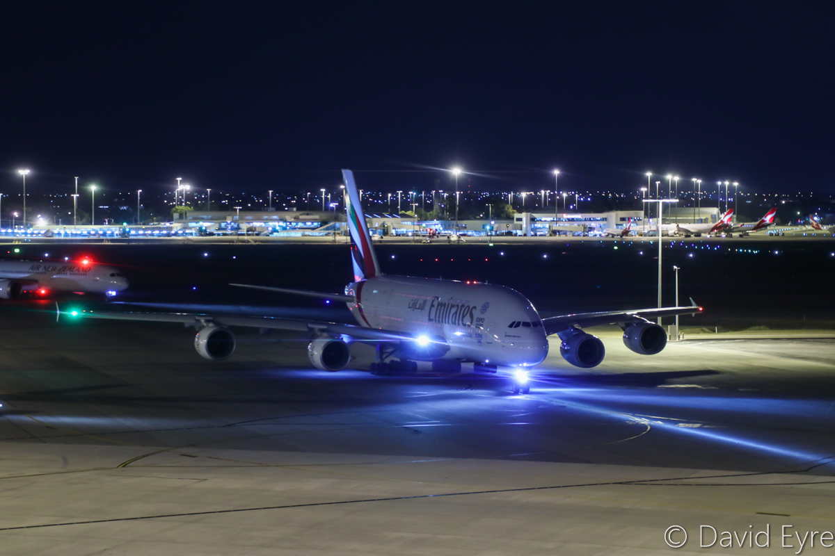 A6-EDC Airbus A380-861 (MSN 016) of Emirates, at Perth Airport - Thu 6 April 2017. Flight EK421 to Dubai, about to taxy out to runway 21 at 10:16pm. Behind is ZK-NZI Boeing 787-9 Dreamliner of Air New Zealand. Photo © David Eyre