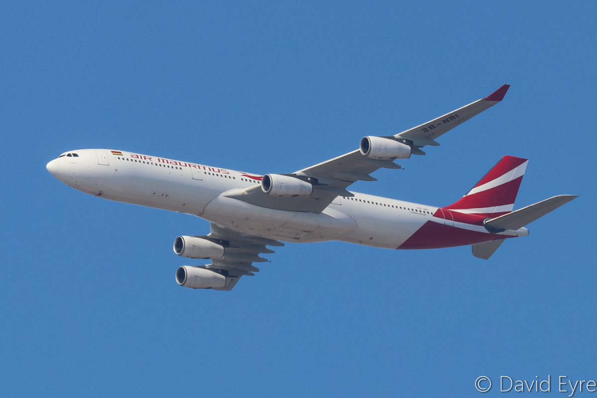 3B-NBI Airbus A340-313 (MSN 793) of Air Mauritius, named 'Le Flamboyant', over the northern suburbs of Perth – Wed 19 April 2017. A rare visit by an Air Mauritius A340 instead of the usual A330-200, operating flight MK440 from Mauritius at 9:40am. Heading northeast along the 9 DME arc before approaching Perth Airport's runway 21. Photo © David Eyre