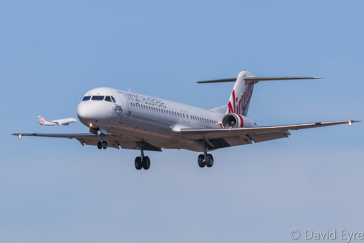 "VH-FNR Fokker 100 (MSN 11488) of Virgin Australia Regional Airlines, named 'Lake Argyle', at Perth Airport - 6 June 2017. Flight VA9200 from Argyle Diamond Mine, landing on runway 03 at 12:12pm. In the background is VH-FNP Airbus A320-231 (MSN 429) of Virgin Australia Regional Airlines, named ""Honeymoon Cove"", on base leg as VA9214 from Boolgeeda. Photo © David Eyre"