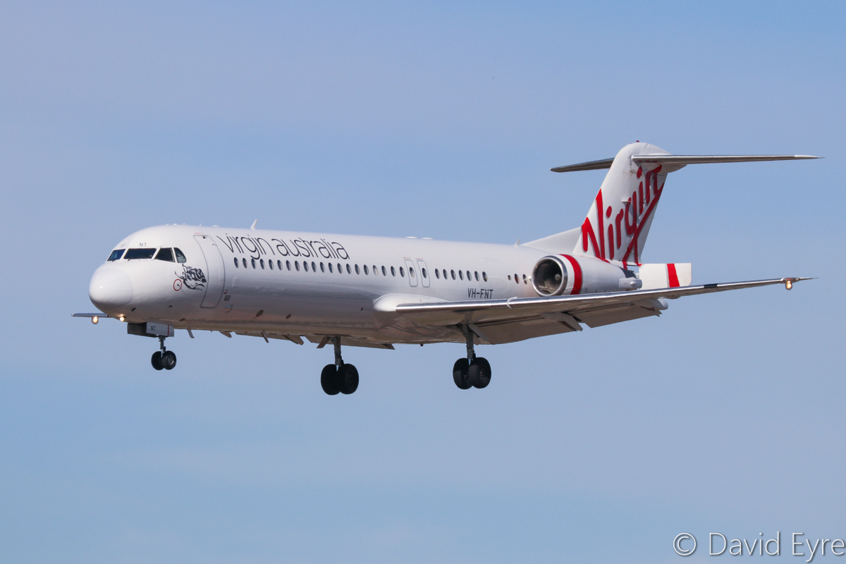 VH-FNT Fokker 100 (MSN 11461) of Virgin Australia Regional Airlines at Perth Airport – 6 June 2017. Landing on runway 03 at 12:25 pm as VA9224 from Busselton. The Fokker 100s in Virgin's fleet are in different configurations - this one has a left side galley service door, just ahead of the engine. Swissair was the first airline to order the Fokker 100 and their MD-80 fleet used a rear Economy Class galley which was accessed through a left-side rear service door, which also acted as an additional emergency exit. Swissair asked Fokker to configure the Fokker 100 the same way and Swissair even designed special Fokker 100 catering vehicles to use the tight space between the wing and left engine. Fokker also shortened the flap track of the left wing to make additional space available for this rear catering door. Guinness-Peat Aviaton Leasing ordered 150 more Fokker 100s in this configuration, which were used by a number of airlines. This one was originally delivered to TAM of Brazil. Photo © David Eyre