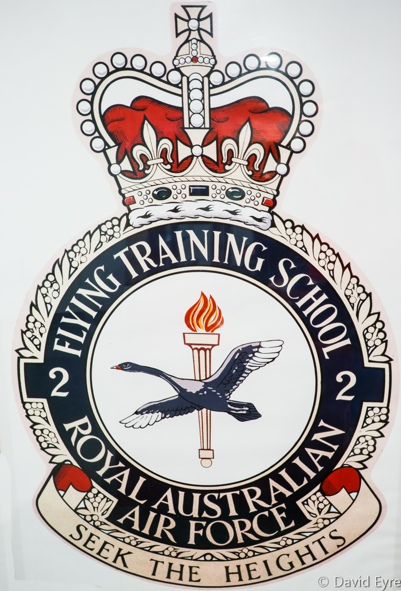 "2 Flying Training School (2 FTS) RAAF Crest, in a crew lounge at RAAF Pearce - Fri 9 June 2017. The 2 FTS crest includes a flame torch to symbolise learning and a black swan to represent Western Australia, where the unit is based, as well as the transition of a student pilot from an ungainly cygnet to a graceful swan. Their motto is ""Seek the heights"". Photo © David Eyre"