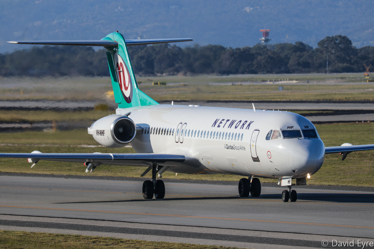 VH-NHF Fokker 100 (MSN 11458) of Network Aviation, at Perth Airport - Fri 9 June 2017. NETLINK 1612 to Port Hedland, taxying to runway 03 at 3:16pm for take-off. Photo © David Eyre
