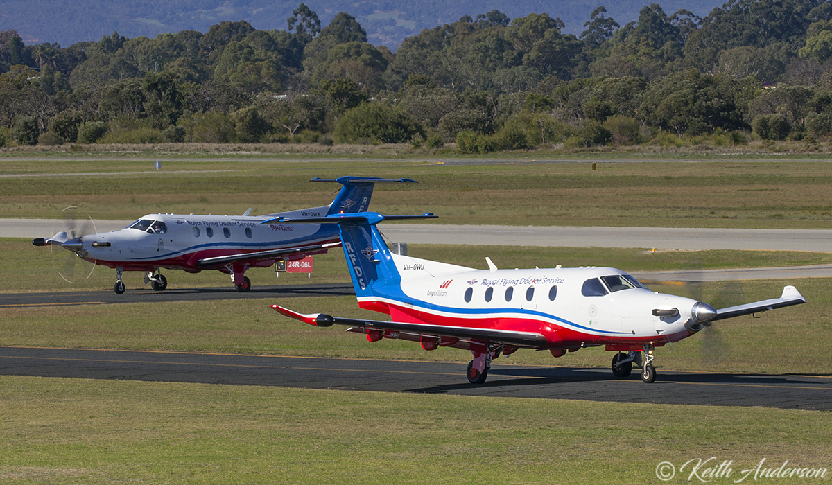 VH-OWJ Pilatus PC-12/47E (MSN 1411) Taxying out, passes VH-OWY Pilatus PC-12/47E (MSN 1663) taxying in both owned by Royal Flying Doctor Service (Western Operations) at Jandakot Airport – 17 June 2017.