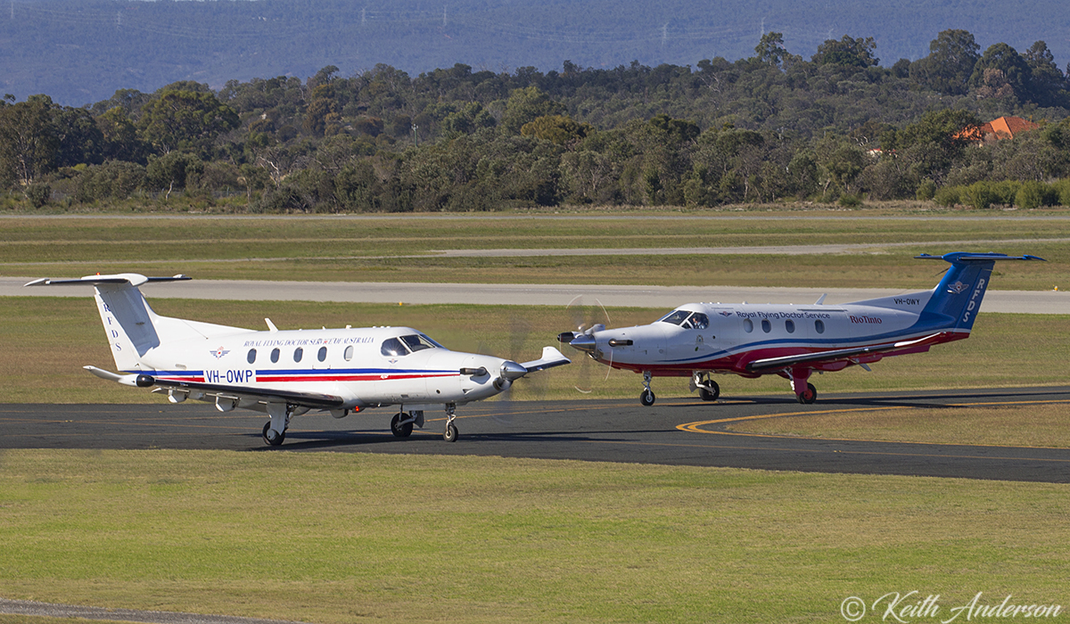 VH-OWP Pilatus PC-12/47E (MSN 1032) Taxying out, passes VH-OWY Pilatus PC-12/47E (MSN 1663) taxying in both owned by Royal Flying Doctor Service (Western Operations) at Jandakot Airport – 17 June 2017.