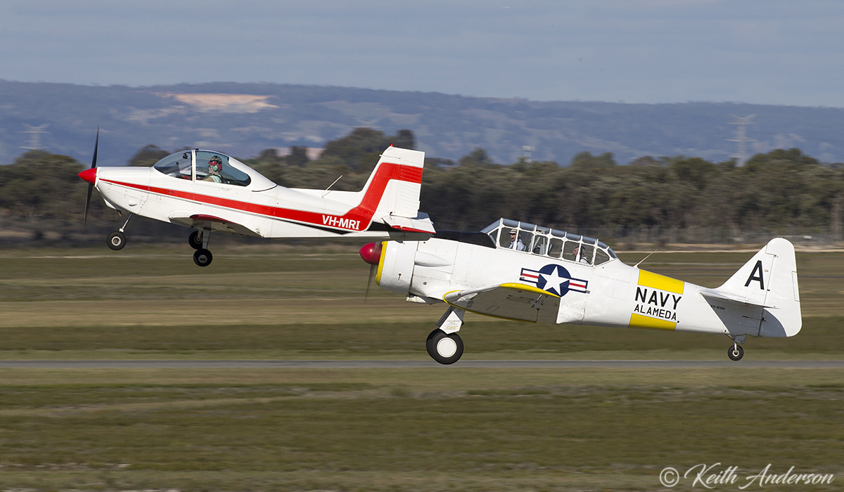 VH-MRI Victa Airtourer 115 (MSN 158) and VH-WWA / A - 106 North American AT-6D Texan (MSN 78-7094) taking off in formation, at Jandakot Airport – 17 June 2017..