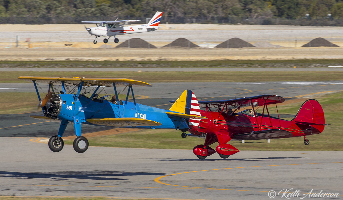 VH-YDF / 4269 / 591 Boeing B75N1 (N2S-3) Stearman (MSN 75-2599B) and VH-YRB WACO Aircraft YMF-F5C (MSN F5C105) taking off in formation at Jandakot Airport - 17 June 2017.