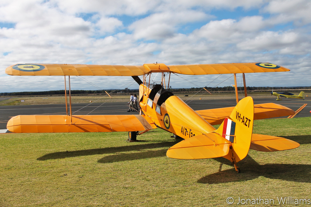 "VH-AZT / ""A17-130"" De Havilland DH82A Tiger Moth (MSN DHA853) owned by Farm Nominees Pty Ltd of Yoongarillup, WA, at Busselton Airport - 6 March 2016. Built in 1942 by De Havilland Aircraft at Bankstown, serial DX810 was not taken up and it was delivered to the RAAF as A17-721. Sold by the RAAF, it was registered VH-AZT on 27 September 1946 to the Royal Queensland Aero Club in Brisbane. In 1959, the fuselage of VH-BCW (MSN DHA127), ex A17-130 of the RAAF (which had been withdrawn from use on 10 October 1947) was used in a major rebuild, prior to sale. The rebuilt aircraft kept registration VH-AZT and MSN DHA853. In 1960 it moved to Perth with John Forrest Pty Ltd but in May 1970 was withdrawn from use. In 1982, it returned to the register as VH-AZT. Now painted in RAAF markings as VH-AZT, but with the serial A17-130 from the fuselage of VH-BCW which was used in its rebuild. Photo © Jonathan Williams"