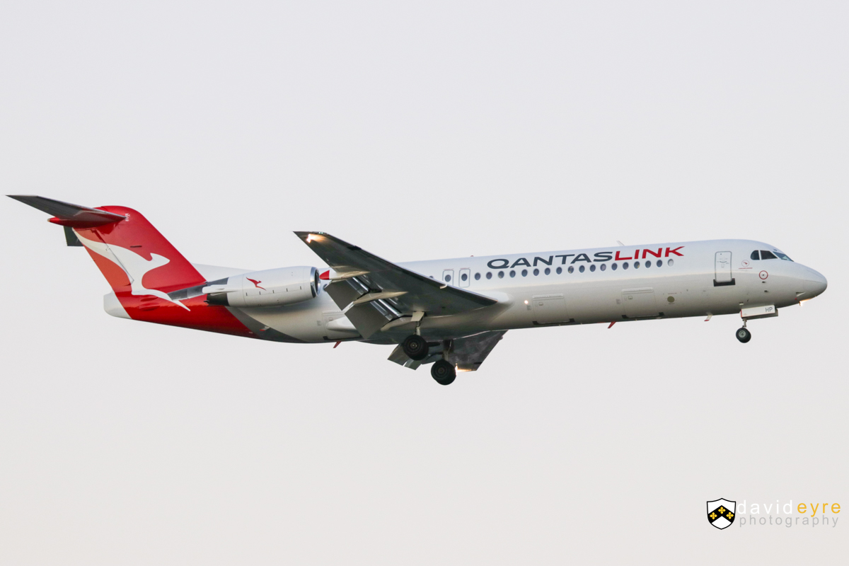 VH-NHP Fokker 100 (MSN 11399) of QantasLink at Perth Airport -1 August 2017. The first Fokker 100 to be painted in the new QantasLink livery. NETLINK 1683 from Fortescue Dave Forrest (Cloudbreak), on final approach to runway 21 at 5:41pm. Photo © David Eyre