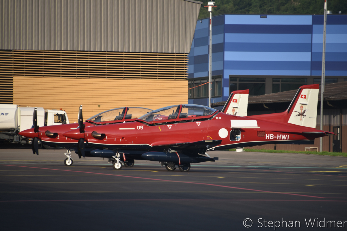 HB-HWI/A54-009 (MSN 242) and HB-HWH/A54-010 (MSN 243) Pilatus PC-21 of the Royal Australian Air Force, in 2 Flying Training School markings, at Stans, Switzerland – Fri 4 August 2017. On the day they departed the Pilatus Aircraft facility at Stans, Switzerland on their delivery flight to Australia. Photo © Stephan Widmer