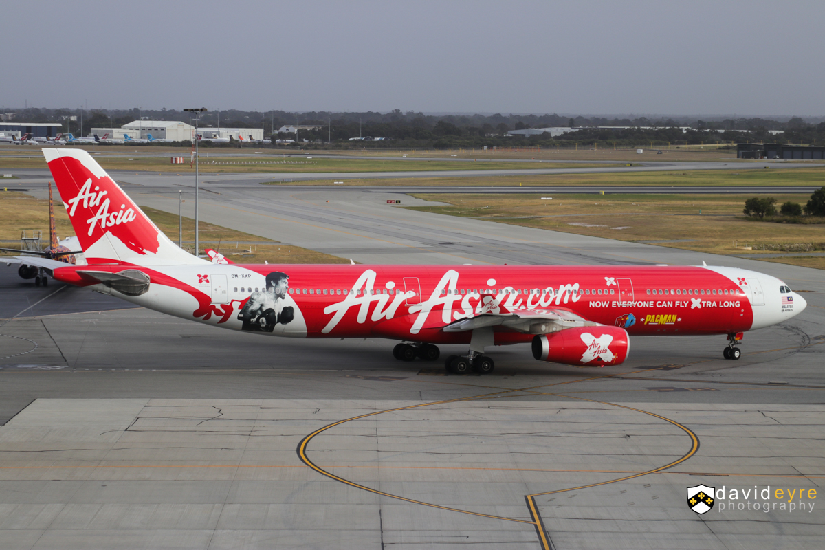 """9M-XXP Airbus A330-343X (MSN 1481) of AirAsia X, named 'Xiao Long Bao', with 'Manny Pacquiao - Pacman' decals, at Perth Airport – 29 Oct 2017. Flight D7 237 to Kuala Lumpur, taxying out to runway 21 at 7:01am. This aircraft flew Manny """"Pacman"""" Pacquiao and his team from their training camp in General Santos City in the Philippines to Brisbane on 2 July 2017 for his World Boxing Organization (WBO) title defence against Australia's Jeff Horn. Pacquiao is the only boxer to have won titles in eight weight classes. The Pacman decal is on the rear fuselage on the left side of the aircraft. Photo © David Eyre"""