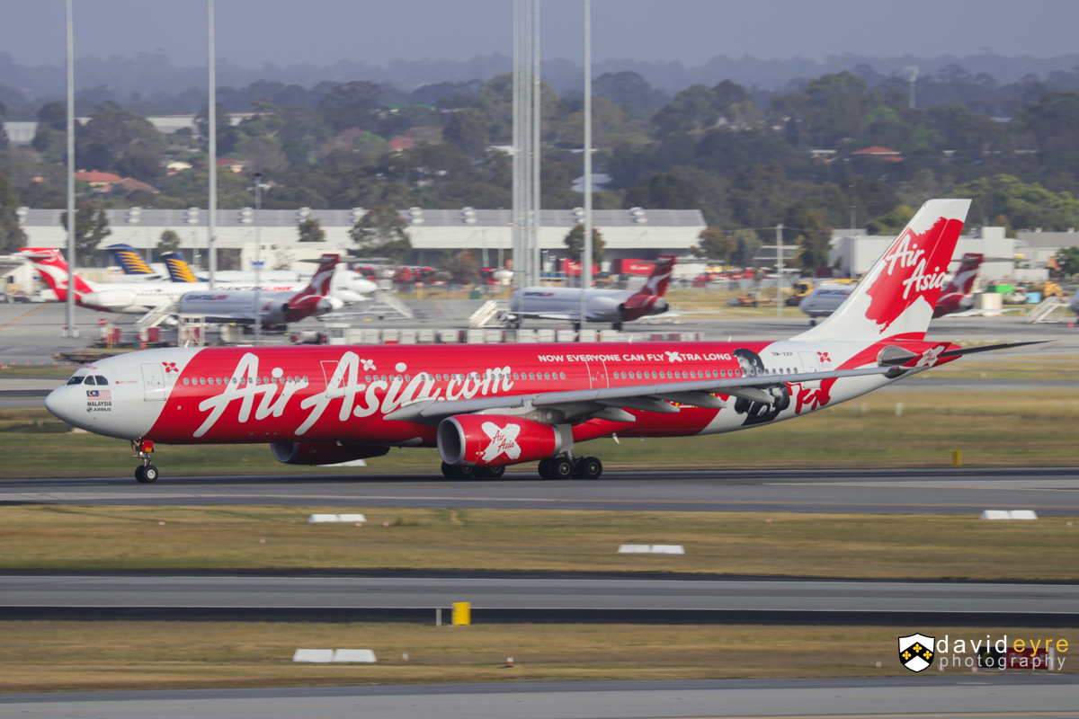 """9M-XXP Airbus A330-343X (MSN 1481) of AirAsia X, named 'Xiao Long Bao', with 'Manny Pacquiao - Pacman' decals, at Perth Airport – 29 Oct 2017. Flight D7 237 to Kuala Lumpur, taking off from runway 21 at 7:07am. This aircraft flew Manny """"Pacman"""" Pacquiao and his team from their training camp in General Santos City in the Philippines to Brisbane on 2 July 2017 for his World Boxing Organization (WBO) title defence against Australia's Jeff Horn. Pacquiao is the only boxer to have won titles in eight weight classes. The Pacman decal is on the rear fuselage on the left side of the aircraft. Photo © David Eyre"""