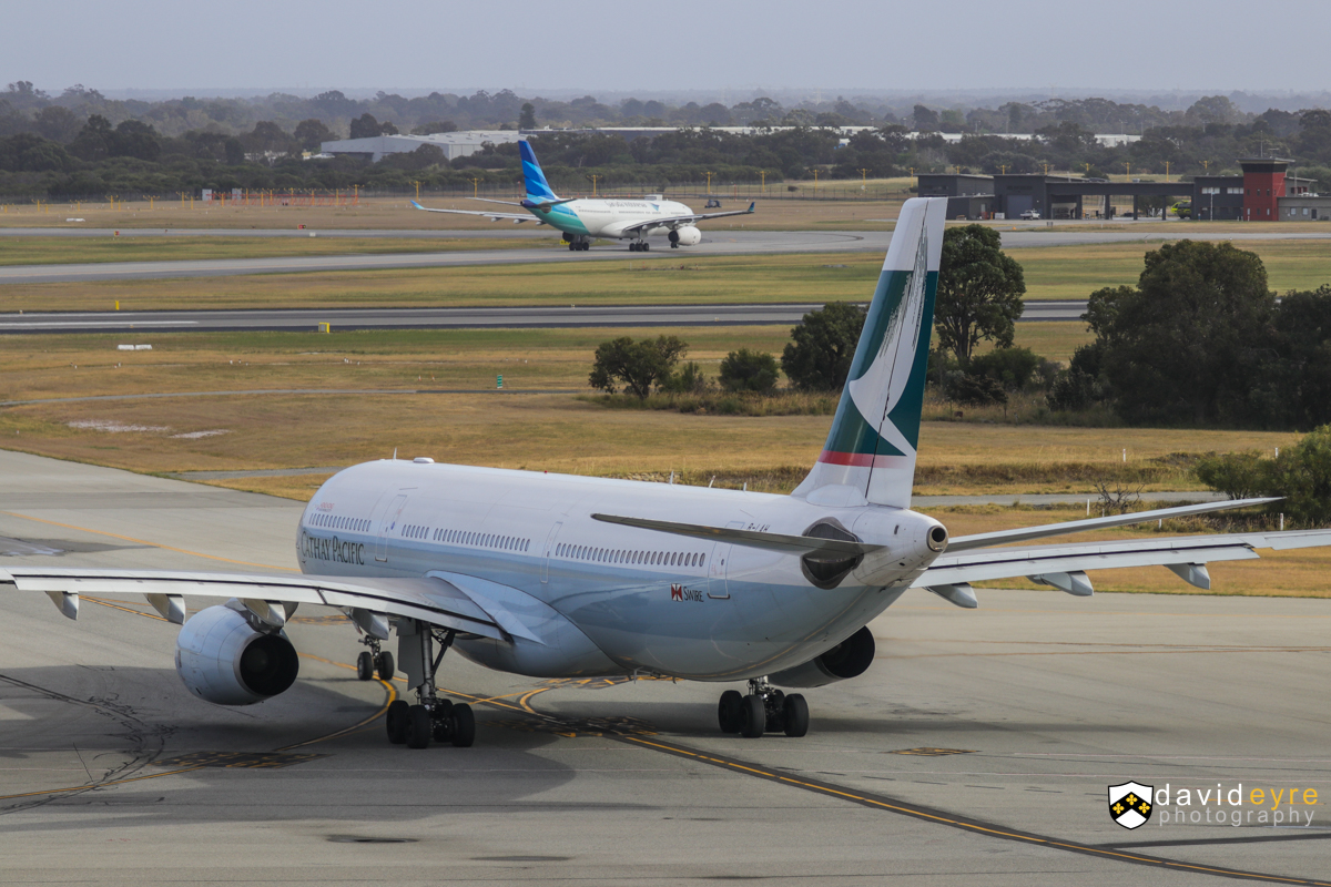 B-LAH Airbus A330-343X (MSN 915) of Cathay Pacific, at Perth Airport - 29 October 2017. Flight CX136 to Hong Kong, taxying out at 7:36am. In the background is PK-GPP Airbus A330-243 (MSN 1364) of Garuda Indonesia, taxying out to runway 21 to depart as flight GA727 to Denpasar. Photo © David Eyre