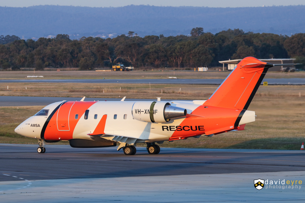 VH-XNF Bombardier CL-600-2B16 Challenger 604 (MSN 5656) owned by Cobham SAR Services Pty Ltd, operated for the Australian Maritime Safety Authority (AMSA), at Perth Airport - 1 November 2017. Arriving back from a search and rescue exercise at 6:18pm - note that one thrust reverser is deployed as it taxies in. The long radome under the forward fuselage is a multi mode search radar, whilst the smaller fairing just in front of it contains a search and rescue direction finder. Built in 2006, ex C-FOGX, N338FX, C-FIXN, C-GLXY. Photo © David Eyre