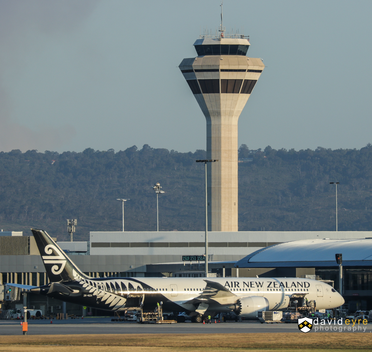 ZK-NZH Boeing 787-9 Dreamliner (MSN 37964/351) of Air New Zealand with the control tower behind, at Perth Airport - 1 November 2017. Flight NZ176 to Auckland, parked at Bay 150 at 5:56pm - it departed at 6:54pm. Photo © David Eyre