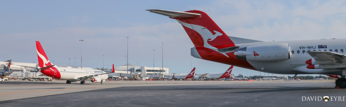 Qantas aircraft at Terminal 4 at Perth Airport - 2 November 2017. VH-VZT Boeing 737-838 (MSN 34186/3798) of Qantas, named 'Kalgoorlie', taxying in at 7:32am as QF593 from Adelaide. VH-VZA Boeing 737-838 (MSN 34195/2502) of Qantas, named 'Port Augusta', parked at Bay 15, prior to departing as flight QF668 to Adelaide. VH-ZNA Boeing 787-9 Dreamliner (MSN 39038/615) of Qantas, named 'Great Southern Land', on its first visit to Perth. It arrived the previous evening as flight QF481 from Melbourne and stayed on Bay 14 overnight for Qantas staff training and familiarisation. It departed today at 8:21am as QF762 to Melbourne, with a water cannon salute as it taxied out and it circled Perth at around 2,000 feet after take-off before continuing on its way. In the foreground is VH-NHJ Fokker 100 (MSN 11464) of QantasLink (Network Aviation) parked at Bay 914. It departed at 12:48pm to Learmonth as QF1642. Photo © David Eyre.