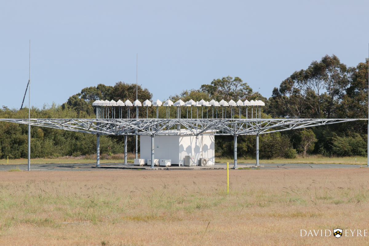 VOR (VHF Omnidirectional Range) antenna at Perth Airport - 2 November 2017. The VOR transmits radio signals outwards in radials (like spokes of a wheel) to enable aircraft with VOR receivers (usually in the vertical fin) to detect the signal and navigate to/from or over the antenna. Photo © David Eyre