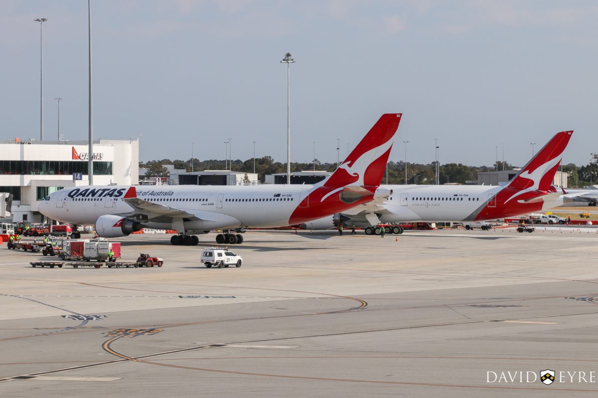 VH-EBD Airbus A330-202 (MSN 513) of Qantas, named 'Traralgon', and VH-ZNA Boeing 787-9 Dreamliner (MSN 39038/615) of Qantas, named 'Great Southern Land', at Perth Airport - 2 November 2017. VH-ZNA was on its first visit to Perth - it arrived the previous evening as flight QF481 from Melbourne and stayed on Bay 14 overnight for Qantas staff training and familiarisation. It departed today as QF762 to Melbourne, with a water cannon salute as it departed and circled Perth at around 2,000 feet after take-off before continuing on its way. VH-EBD is operating flight QF565 from Sydney, taxying in to park at bay 15, Terminal 4 at 8:10am. Photo © David Eyre