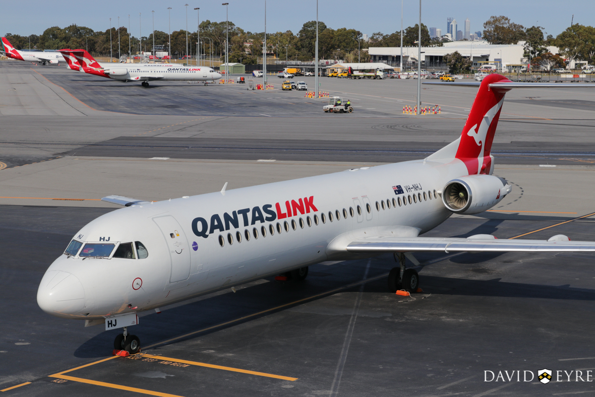 VH-NHJ Fokker 100 (MSN 11464) of QantasLink (Network Aviation) at Perth Airport - 2 November 2017. Parked at Bay 914. It departed at 12:48pm to Learmonth as QF1642. Photo © David Eyre.