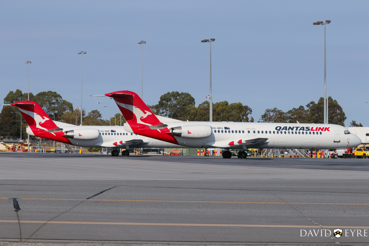 VH-NPU (MSN 11502) and VH-NQE (MSN 11457) Fokker 100 of QantasLink (Network Aviation) at Perth Airport - 2 November 2017. Parked south of Terminal 3. Photo © David Eyre