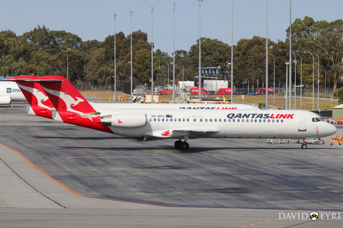 VH-NPU Fokker 100 (MSN 11502) of QantasLink (Network Aviation) at Perth Airport - 2 November 2017. Parked south of Terminal 3. VH-NQE is just behind. Photo © David Eyre