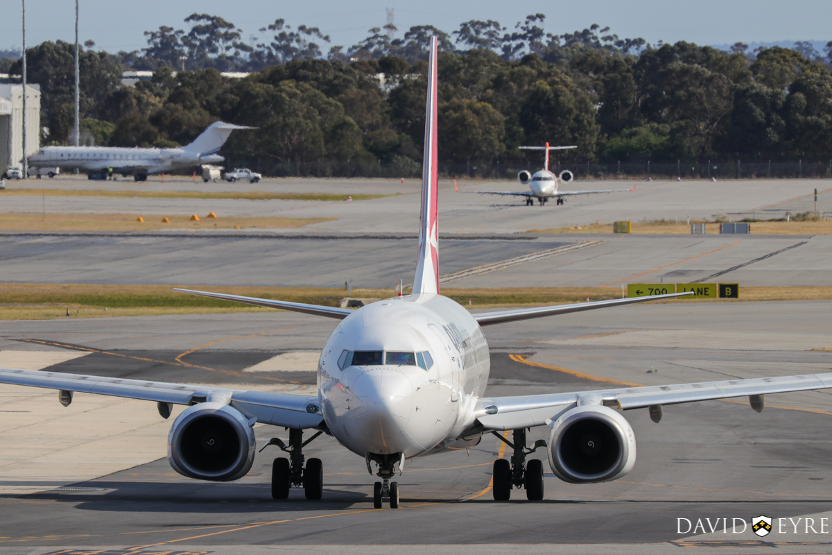 VH-VZA Boeing 737-838 (MSN 34195/2502) of Qantas, named 'Port Augusta', at Perth Airport - 2 November 2017. Taxying out from Terminal 4 at 8:07am as flight QF668 to Adelaide. In the background is VH-IQR Bombardier BD-700-1A10 Global Express (MSN 9230) of Execujet Australia and with nose to camera is VH-XNF Bombardier CL-600-2B16 Challenger 604 (MSN 5656) owned by Cobham SAR Services Pty Ltd, operated for the Australian Maritime Safety Authority (AMSA). Photo © David Eyre
