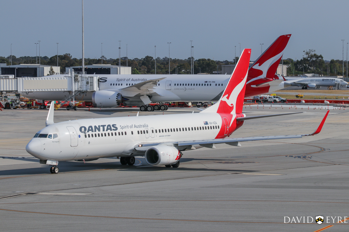 VH-VZA Boeing 737-838 (MSN 34195/2502) of Qantas, named 'Port Augusta', at Perth Airport - 2 November 2017. Taxying out from Terminal 4 at 8:08am as flight QF668 to Adelaide. In the background is VH-ZNA Boeing 787-9 Dreamliner (MSN 39038/615) of Qantas, named 'Great Southern Land', on its first visit to Perth. Photo © David Eyre