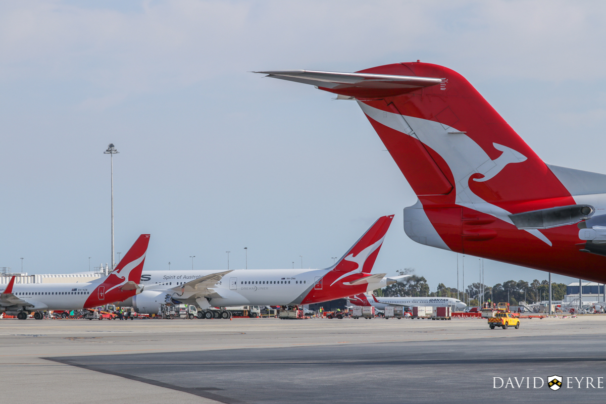 Qantas aircraft at Terminal 4 at Perth Airport - 2 November 2017. VH-VZA Boeing 737-838 (MSN 34195/2502) of Qantas, named 'Port Augusta', parked at Bay 15 at 7:38am, prior to departing as flight QF668 to Adelaide. VH-ZNA Boeing 787-9 Dreamliner (MSN 39038/615) of Qantas, named 'Great Southern Land', on its first visit to Perth. It arrived the previous evening as flight QF481 from Melbourne and stayed on Bay 14 overnight for Qantas staff training and familiarisation. It departed today at 8:21am as QF762 to Melbourne, with a water cannon salute as it taxied out and it circled Perth at around 2,000 feet after take-off before continuing on its way. In the foreground is VH-NHJ Fokker 100 (MSN 11464) of QantasLink (Network Aviation) parked at Bay 914. It departed at 12:48pm to Learmonth as QF1642. Photo © David Eyre.