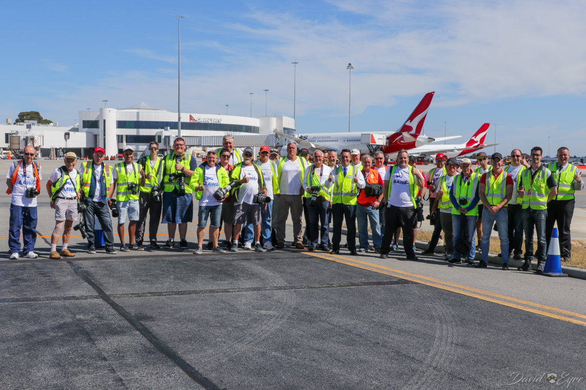 Aviation Association of Western Australia Inc (AAWA) members on the special airside visit at Perth Airport - 3 November 2017. Half of AAWA's 65 members were able to attend the event. Behind at Terminal 4 is Qantas' first Boeing 787-9 Dreamliner, VH-ZNA, making its second visit to Perth. Photo by Brenden Scott.