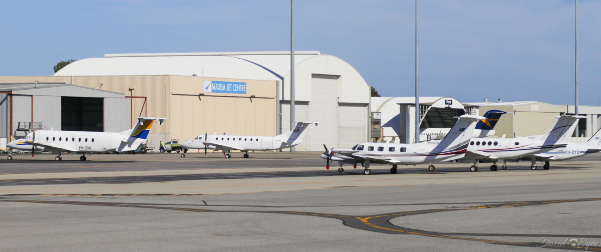 General Aviation area at Perth Airport - 3 November 2017. Aircraft visible include: VH-ZOA Beech 1900D (MSN UE-85) of Ad Astral Aviation; VH-FWA Beech 1900C (MSN UB-61) of Ad Astral Aviation; VH-BUW Piper PA-42-720 Cheyenne III (MSN 42-8001047) owned by Central Air Pty Ltd; VH-LKH Beech 200 King Air (MSN BB-612) of Star Aviation; VH-DYD Piper PA-31-350 Navajo Chieftain (MSN 31-7652119) of Star Aviation; with a Fokker 100 of Alliance Airlines behind. Photo © David Eyre